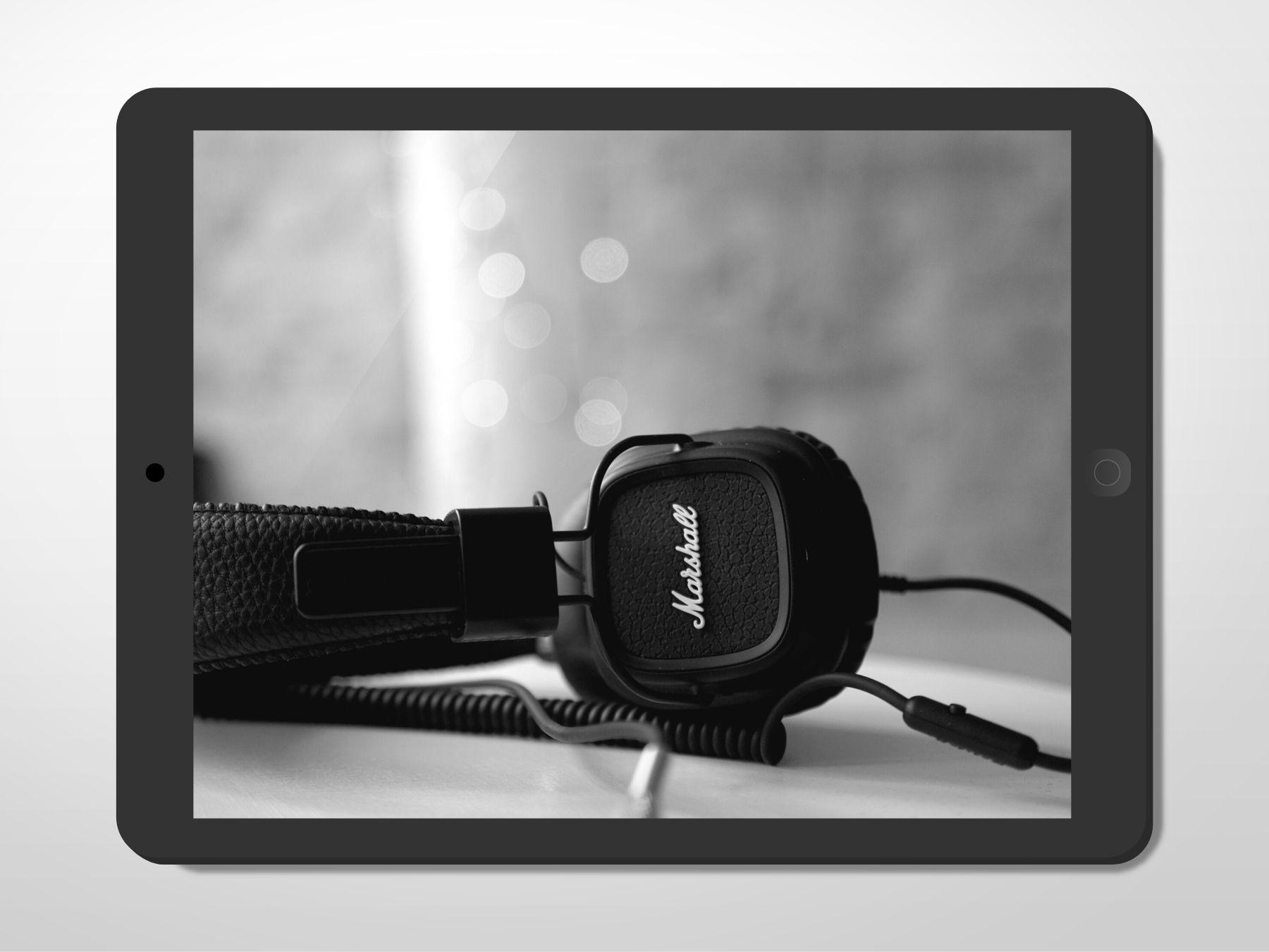 A pair of black Marshall headphones.