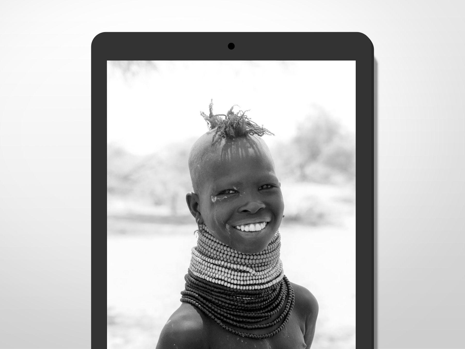 A girl from Turkana, Kenya, smiling at the camera.