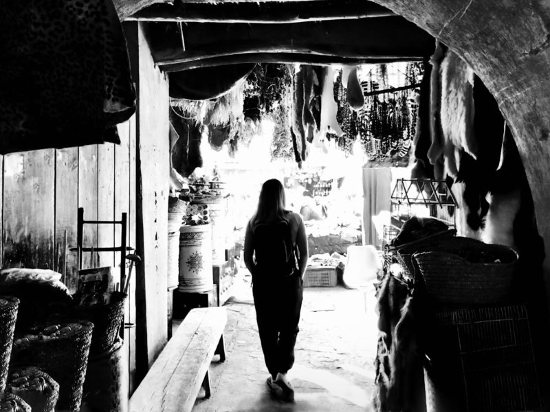 Ruth walking through a souk in Essaouira.